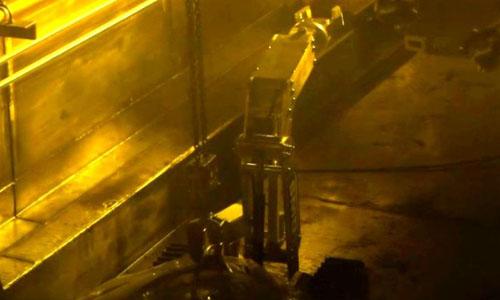 A robot recycling its final batch of reactor fuel.